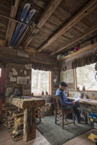 Doug Robinson writing in his Rock Creek cabin